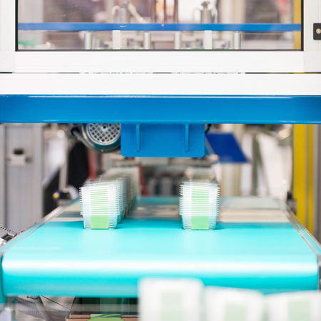 food industry: Manufacturing line, production of plastic containers for food industry Stock Photo