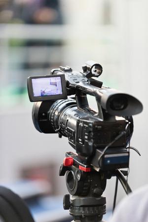 television camera: Television camera recording public event