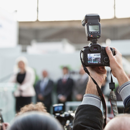 commercial event: Photographer with camera on conference