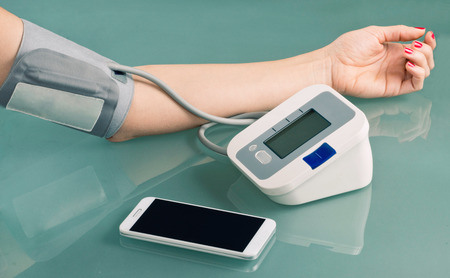 taking pulse: Measuring blood pressure and using smart phone to follow results
