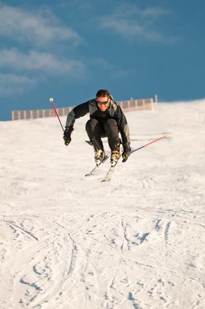 skier jumping: Male skier jumping fresh powder
