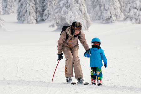 two persons only: Young female and little boy skiing
