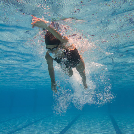 crawl: Underwater shot of a front crawl swimmer