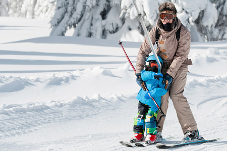 two persons only: Mother and son on ski lift ready for skiing