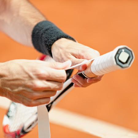 grip: Putting new grip tape on tennis racket