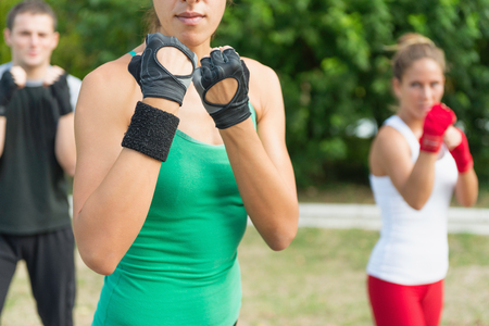 three persons only: Tae Bo team in guard positions Stock Photo