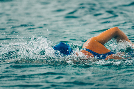 Open Water Swimming. High speed action shot, shallow depth of field, toned.