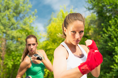 fighting stance: Two girls in a fighting stance