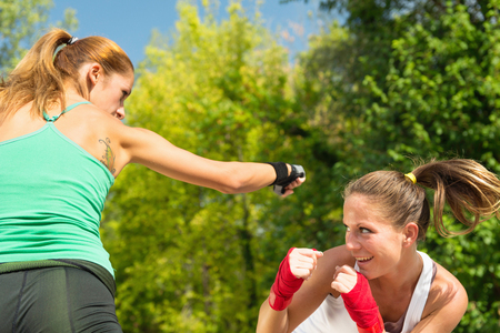 two persons only: Two girls TaeBo boxing Stock Photo