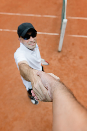 umpire: Tennis player shaking hands with chair umpire after the match