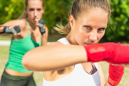 two persons only: Beautiful young woman in TaeBo exercise class