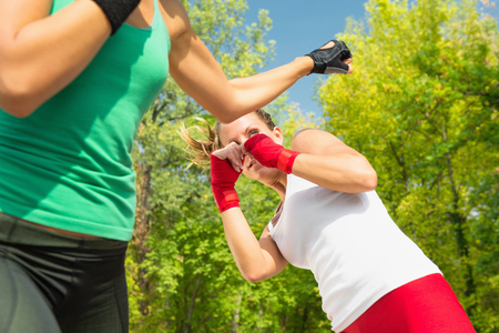 two persons only: Two young women sparring, focus on eye Stock Photo