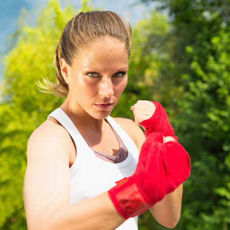 female fighter: Portrait of beautiful female fighter Stock Photo