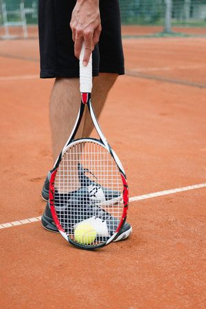 picking up: Player picking up ball, detail from tennis game Stock Photo