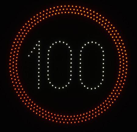speed limit sign: LED light speed limit sign on black background - 100