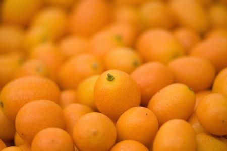 citrus family: Kumquat fruit, citrus family similar to orange, focus in the center, strong depth of field Stock Photo