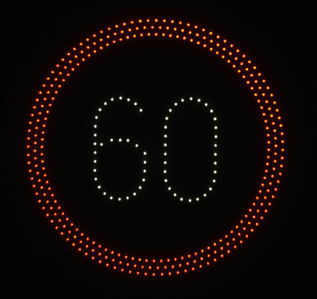 speed limit sign: LED light speed limit sign on black background - 60
