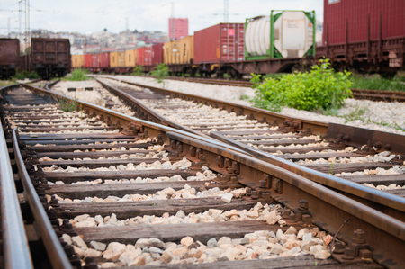 railroad tracks: Railroad tracks in focus with blurred cargo trains in background