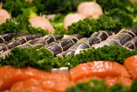 stuffed fish: Fresh stuffed mackerels at the fish market. Focus set on mackerels over salmon steaks