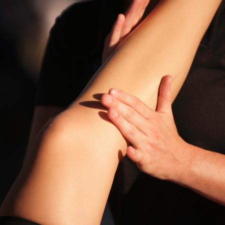 soleus: Sport therapist massaging athletes calf muscles