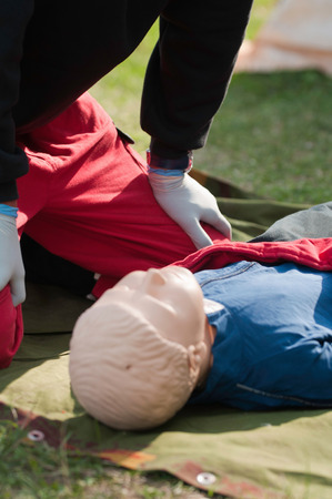paramedic: Paramedic over a CPR dummy in resucitation training Stock Photo