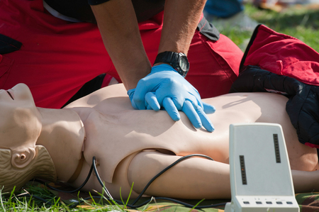 compressions: Resuscitation practice with CPR dummy