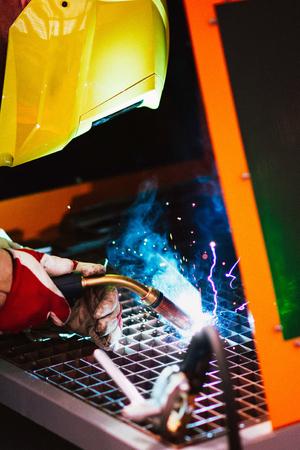 metal worker: Industrial welder - Metal worker with protective workwear using welding torch