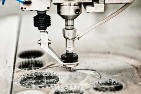 Waterjet cutting CNC machine, using water under high pressure to pierce through thick sheet of metal. 스톡 콘텐츠