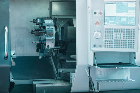 toolroom: Automated CNC toolroom lathe with control console