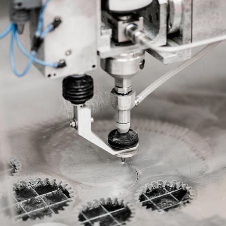 pierce: Waterjet cutting CNC machine, using water under high pressure to pierce through thick sheet of metal. Stock Photo