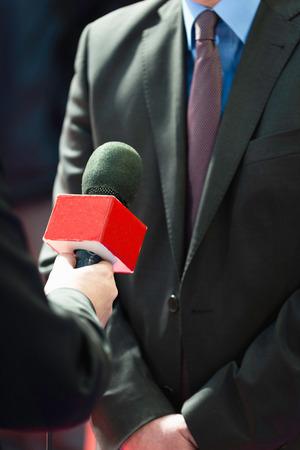 tv reporter: TV reporter interviewing businessman