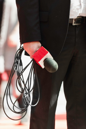 tv reporter: TV Reporter with microphone, waiting Stock Photo