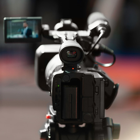 commercial event: Camera recording on press conference