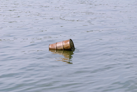 polution: Water pollution - floating barrel in the poluted river Stock Photo