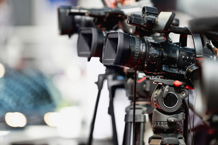 medium group of objects: Television cameras on press conference