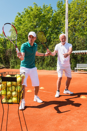 70s tennis: Tennis class with active senior man