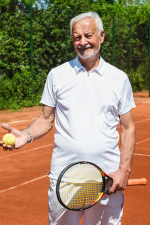 70s tennis: Portait of active senior tennis player Stock Photo