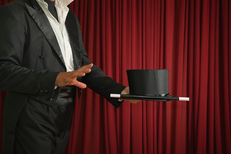 magic trick: Magician ready to perform magic trick on stage