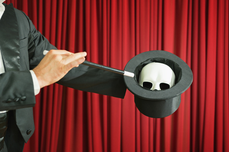 skull mask: Magician performing with skull mask on stage