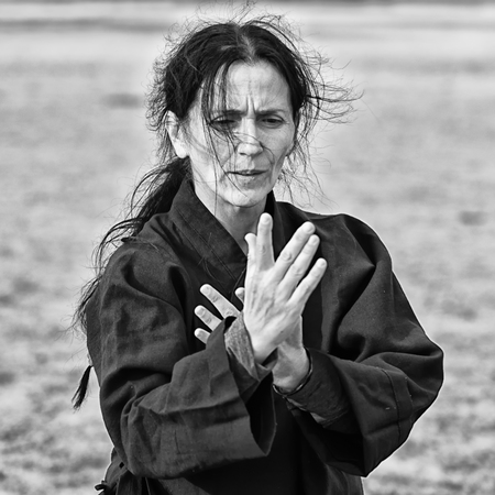 Woman doing Qi Gong, high contrast