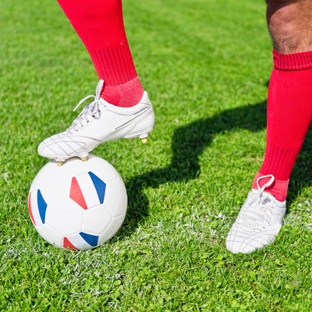 kickoff: Soccer player ready to kick-off ball with French flags