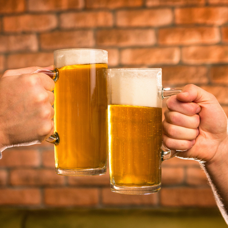 drinks after work: Beer steing toating in pub Stock Photo