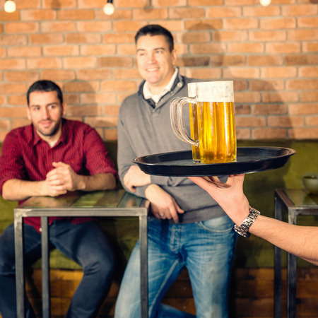 drinks after work: Beer is coming Stock Photo
