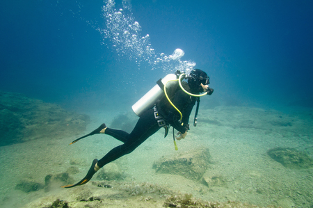 Young female scuba diver underwater