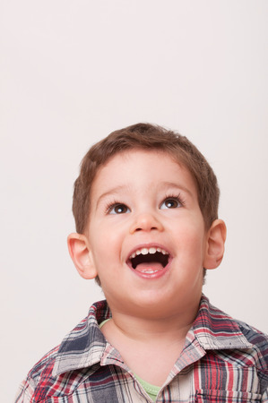 2 year old: Portrait of a cute 2 year old boy looking up. Isolated on white, convenient copy space above