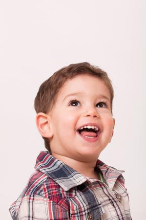 potrait: Potrait of a happy 2 year boy looking up