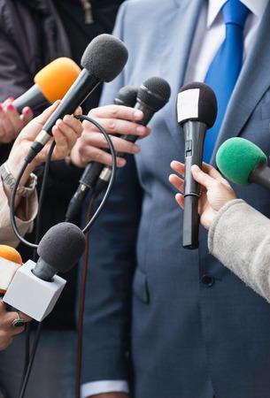 public figure: Media interview with politician - group of journalists surrounding public figure