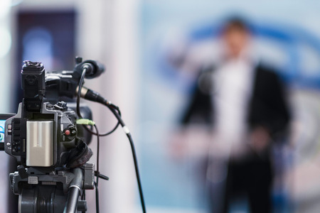 commercial event: Cameraman recording  press conference Stock Photo
