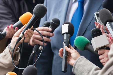 prime adult: Media interview - group of journalists surrounding VIP Stock Photo