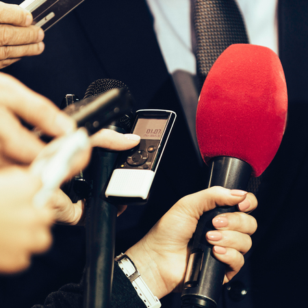 spokesman: Journalists interviewing businessman on public event Stock Photo